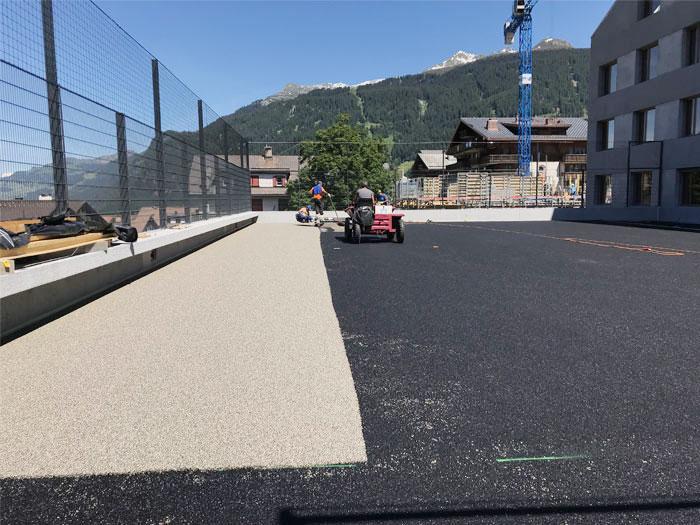 Einbau Sportbeläge Schulanlage Klosters-Serneus